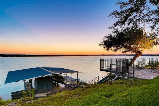 Incredible, FLAT 2 acre lot on DEEP water. Main body views of the sailing basin. SPECTACULAR BACKYARD includes pool, jacuzzi, full sand volleyball court, fire pit, surround sound and still plenty of room to toss the football. 200' of deep water frontage, as good as waterfront gets on Lake Travis. Large boat dock. House has been updated in last few years. Could be 6 bedrooms or even 7 if including dedicated study. Lake Travis Paradise. Serene, tranquil, and private. Nature lovers dream.