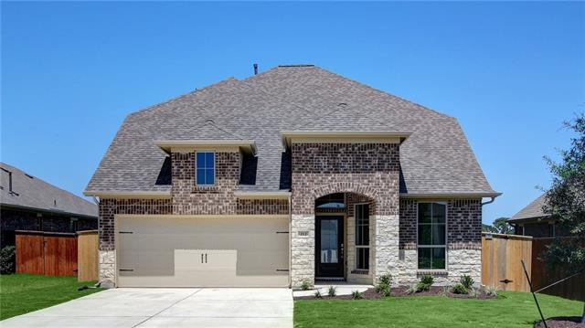 Two-story entry with 19-foot ceilings. Kitchen with a walk-in pantry opens to family room. Two-story family room with a wall of windows. Private master suite with a wall of windows. Master bath includes dual vanity sinks, garden tub, separate glass-enclosed shower and walk-in closet. Game room located on the second floor. Mud room. Two-car garage.