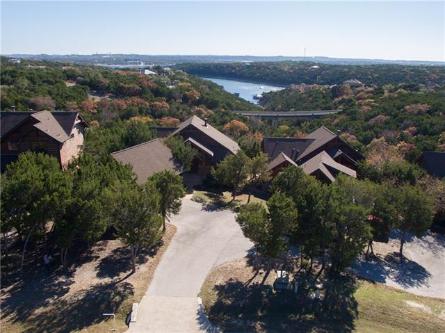 RESORT STYLE LIVING ON THE NORTH SHORE OF LAKE TRAVIS! Community Beach Club/Marina/Store ~ THIS HOUSE CAN BE SOLD FULLY STOCKED/FURNISHED! Garage 2nd Story Can Easily Be Converted to Additional Living Space! ~ Panoramic Views of Hill Country and Lake Travis! ~ Fire Pit ~ Beautiful Luxurious Log-Cabin Feel ~ Large Walk-In Shower in Master ~ Open Layout ~ Floor to Ceiling Stone Fireplace ~ Large Rear Covered Deck ~ Very Quiet/Peaceful ~ 10 Min to Cedar Park ~ MAKE SURE TO SEARCH YOUTUBE FOR HD VIDEO TOUR!