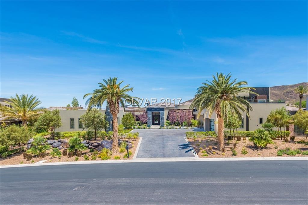 Absolutely Stunning Estate in Prestigious MacDonald Highlands. Extremely rare SINGLE STORY custom home located behind the double gated section on Lairmont. Boasting 8500+ square feet of luxury with amazing golf course frontage. Onyx fireplace, double island kitchen, stadium seat movie theater, separate party/ event area with party deck and unobstructed views of the Las Vegas Strip. Luxury is all in the details.