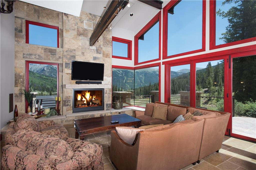 This rustic modern home features iron beams and other mining accents that tie the past in with the future. Ski in/out access allows you to walk onto your patio and store your gear in the ski locker room. This home offers the best of both worlds with easy access to all of Summit County ski areas and just a short drive to Vail and Beaver Creek. Expansive views of the Tenmile Range and the backside of the Breckenridge Ski Area can be enjoyed through the wall of windows of this home.