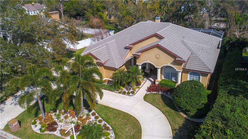 Beautiful & elegant home in a secluded & highly sought after area of Seminole! Huntington custom designed home, Windsor II model, barely 10 yrs old & still w/many new upgrades, meticulously maintained by original owner & where pride of ownership abounds. Gorgeous one level house w/4000+ total SF,4 bedrooms + den,3 baths,3 car garage,solar heated pool & spa + gas heater,crown moldings,tray ceilings,built in niches/alcoves,wood burning fireplace,split plan,super spacious kitchen w/island, breakfast bar,desk space,wood cabinetry & granite counters. House is light & bright w/high ceilings,glass doors & windows revolving around pool & spa,overlooking lush plants & foliage. Hardwood flrs from grand foyer when you go through the custom made front door to dining area & living rm. Den could also serve as another guest room,nursery,gym,office,playroom. Grand Master suite w/double walk in closets,view of the pool & lanai, its sweeping master bath w/double sinks, vanity, separate tub,wrap around shower & private W.C. closet will amaze you. Separate laundry room w/front loaders includes sink & linen closet. House comes w/generator for hurricane season. This prestigious residence is a bike ride away from the Beach, Milleneum Park, supermarket, restaurants. Walking distance to Seminole Schools & a car hop to the new Seminole City Center. There is not enough space in MLS to describe this private residence with all its bells and whistles.  You just have to come and see it.  Please check out the walking tour of the house.