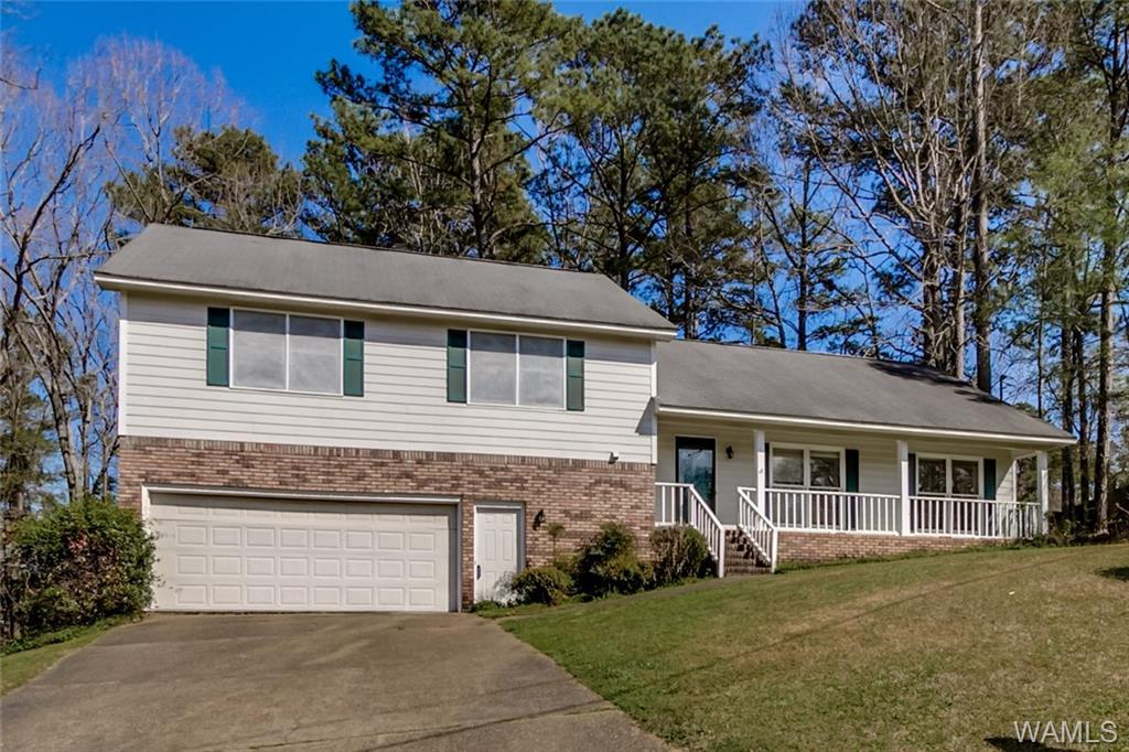 Enjoy these beautiful surroundings in Northwood Lake.  Custom 4 bedroom, 3 bath home.  Perfect for entertaining; large formal living room and dining room; in-law (or outlaw) quarters downstairs with full bath and bedroom or use as an office.  Don't wait long or this one will be gone!