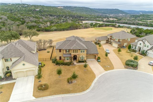 Breathtaking hill country views from the 14th green! Sunning grand entry opens into hardwood floors wrapping through this open living concept with a fireplace. Breathtaking kitchen features impeccable grotto over 6 burner stove, stone Artisan Chiseled Granite Island, built in stainless appliances, granite counters, subway tile back splash, breakfast bar, deep stainless sink, and incredible cabinet space.  Relax in bed while enjoying breathtaking hill country views! Entertainers paradise, 2 stunning decks!