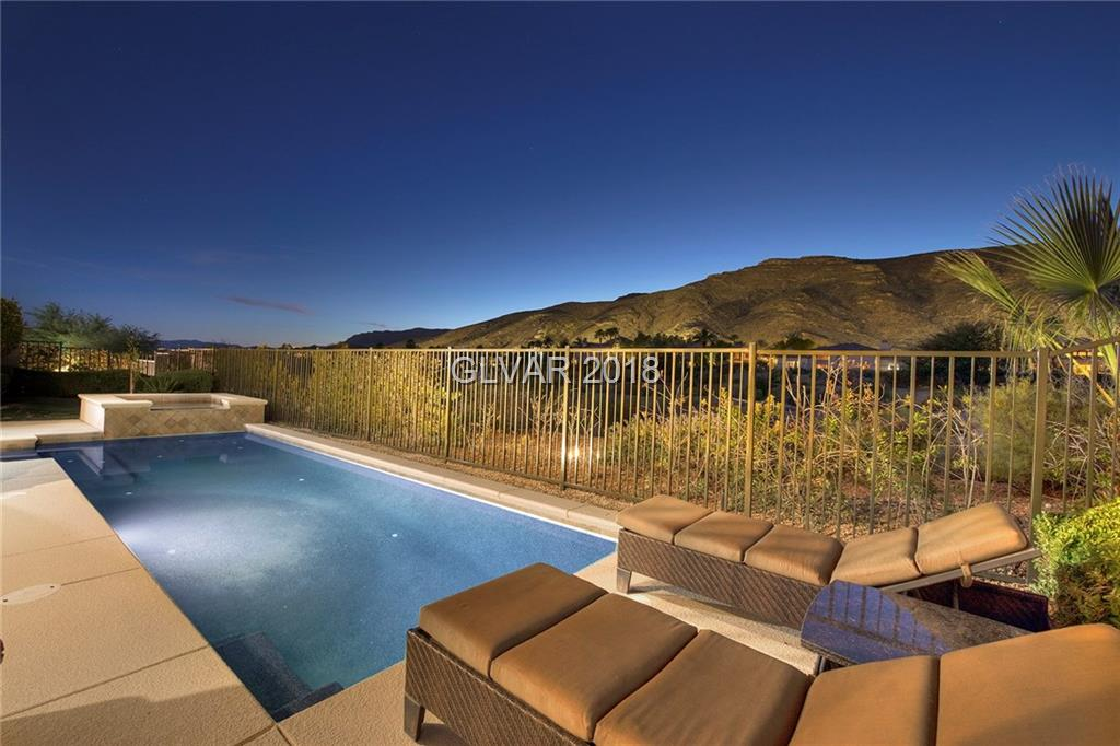 Location, Location, Location! Exquisite Mesquite Model Pool Home sitting on Hole 2 of Arnold Palmers Private Mountain Golf Course with Captivating Mountain Views! This is truly a Golfers Paradise! Features include 5 Bedrooms, 4.5 Baths, Den, Loft, 3 Car Garage, Courtyard, Granite Finishes, Upgraded Cabinets, Stainless Steel Appliances, NEW AC'S, Pebble Tech Heated Pool & Spa, Master Balcony and the Home sits on a GRAND LOT just over 10,800 SQFT!!