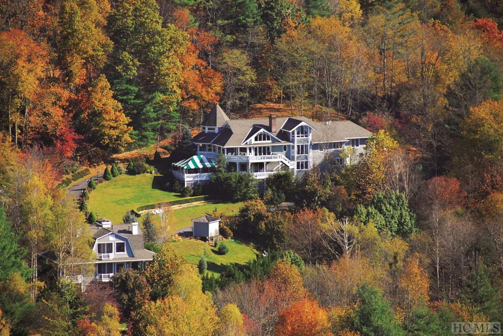 Stunning mountain views and glorious sunsets!  Located in Glenville on the Highlands/Cashiers Plateau, this legacy property is perfect for a large family estate, corporate retreat and could be subdivided.  The MAIN HOME is 5 bedrooms/5 baths with large wraparound verandas.  Lovely landscaping includes a lily pond, recirculating waterfall and charming meandering paths through the gardens.  The GUEST QUARTERS has 5 suites and a 1 bedroom apartment all with soaking tubs and wonderful porches to enjoy morning coffee and beautiful sunsets.  There are several future building sites on this 4.7+/- acre estate.  Multiple possibilities and opportunities!  This is a must see property.  Link to B&B website:  http://www.innisfreeinn.com/   Note: Not being sold as a business - ESTATE Home with Guest Quaters and a dock on Lake Glenville!