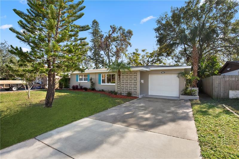 RARELY available Lake Front remodeled 2 bedroom 1 bath single family home, open concept, single car garage with laundry area,beautiful gray wood like ceramic flooring through out, the kitchen features soft close drawers, stainless steel appliances, granite counter tops and an amazing island. Pre-wired for hanging television. Recessed lighting and a plug under front eaves for holiday lighting. This Amazing home features a screened porch, and best of all!! a lot line to lot line lake front lot that is 62 feet by 221 feet! You own to the center of the lake. Enjoy the abundant wild life, kayak or just enjoy a glass of wine by your lake! Living on waterfront is a great tranquil experience! The following items are NEW: windows, roof,water heater,electric panel,insulation (R38),flooring,cabinets,appliances,doors, hardware,paint. Close to shops,food,schools and best of all the BEACH!  Small detached storage shed, BUYER SHOULD VERIFY ROOM MEASUREMENTS.