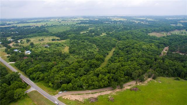 Beautiful 107 Acre (approx) ranch to build your new home on. Two stock tanks. Lots of large pecan and oaks trees. Several cleared areas to build a house. Fenced on two sides. Wet weather creek with some flood plane.  Two tracts (R13365 & R13391).  Survey being completed. 20 Ft Access (0.096 ac) from FM 3000.    Sign at gate entrance from FM 3000.