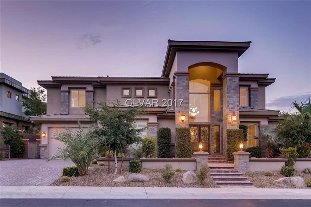 Beautiful custom home with fantastic views of Dragonridge golf course. Enjoy the stunning golf course views along with mountain and city views on the oversized upstairs master balcony. This home also features a fabulous pool with waterfall, yard, and outdoor kitchen. A must see!