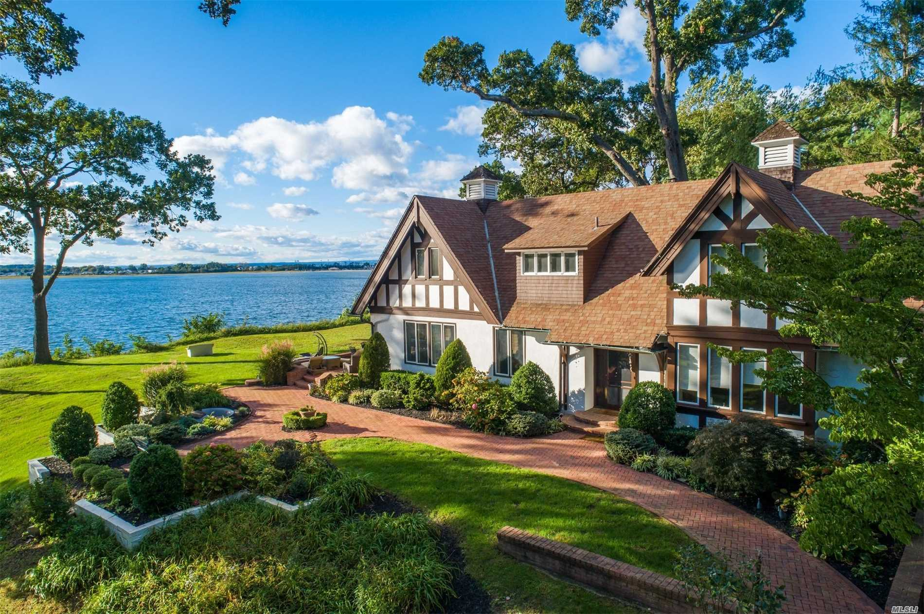 Watch The Boats Sail By From Your Own Patio. Absolutely Gorgeous Views Overlooking Oyster Bay Harbour. Custom Designed Landscaping Surround This Beautiful Tudor On 4 Acres. Formal Living Room With Fireplace, Formal Dining Room, Eat In Kitchen. Full Basement. 2 Bed/2 Full Bath Plus 1 Bedroom Cottage. 3 Car Detached Garage.
