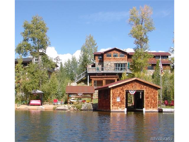 Luxury Waterfront home in Grand Lake. 100' of lake frontage w/private sandy beach, new boathouse and dock, gazebo, greenhouse/ studio, hot tub, and more! This completely updated year-round home features gorgeous views of Mt. Baldy and the lake. With 5 beds/4 baths plus bonus space, there is room for friends and family to share the 'lake life'. Top of the line finishes and mechanical systems; radiant heat, granite, tile, stainless steel appliances, hardwood floors, instant hot water. The charming lake-view living room features an historic stone fireplace from local stone. The main-floor Master suite features custom built-ins, cedar closet, and private patio overlooking the lake. Easy year-round access, convenient to town. Spacious and private. Rare opportunity to own an estate-quality home in the best location on the lake!