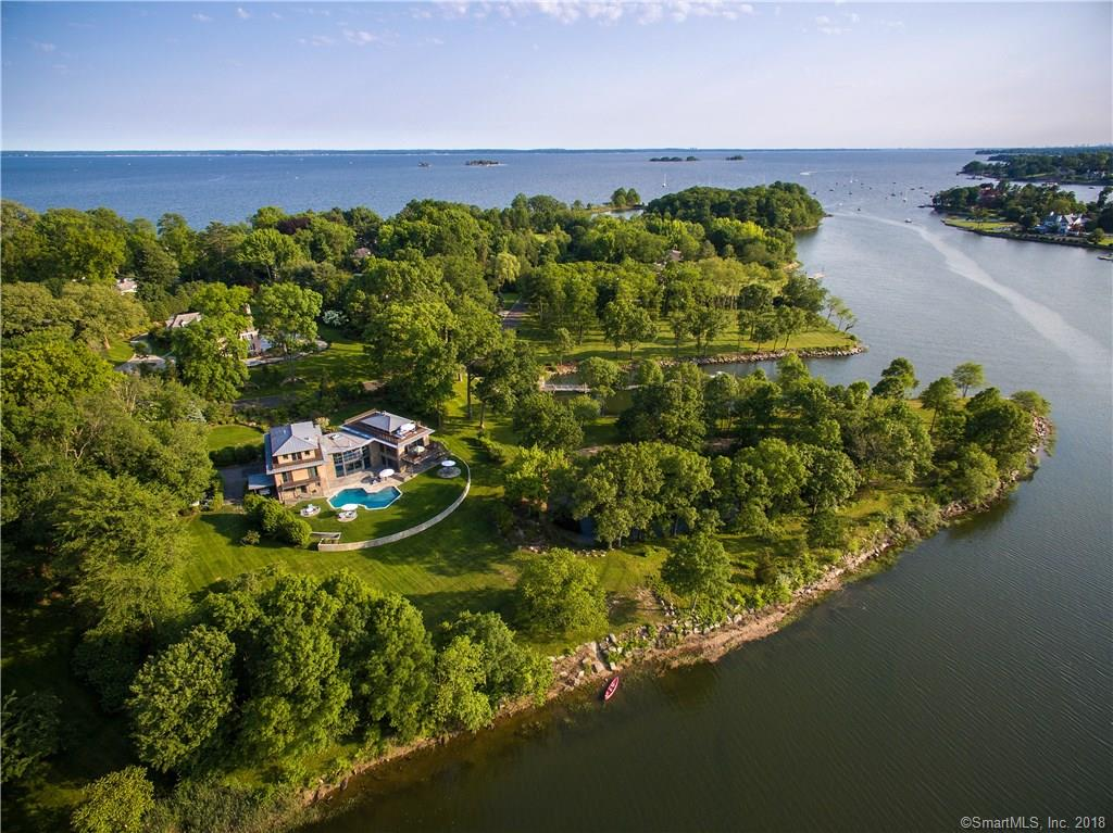 Incredible Mead Point Association waterfront custom 6-bedroom home with unmatched scenic tranquility. First time on the market since completion in 2009. Beautifully sited on 2 level acres with 230 ft. of Long Island Sound frontage. The adjoining 5-acre Windrose Way park features a recently constructed deep water dock and provides natural privacy. This truly one of a kind modern residence blends seamlessly in to the surroundings and provides stunning water views on three levels through floor to ceiling windows. The entire home was built with exceptionally high-quality components starting with steel frame construction, zinc roof, cedar paneled exterior, Ipe decking, aluminum wire railing system and Austrian oak floors plus outstanding European brand doors, cabinets and triple-paned windows.
