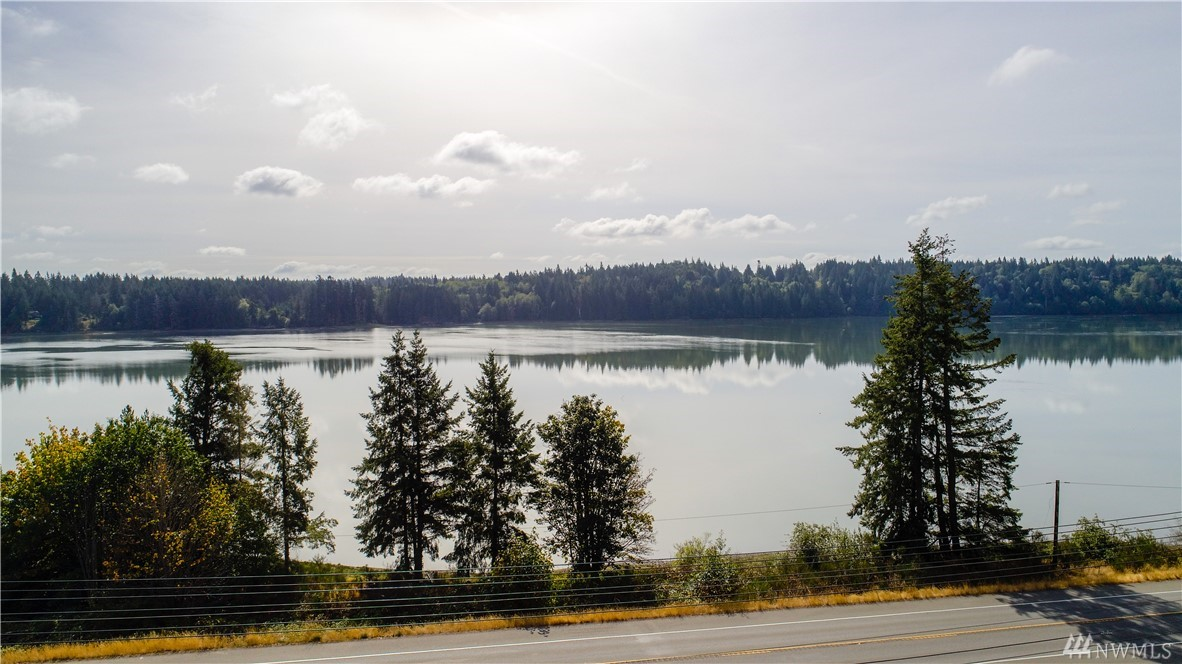 Stunning location with 660± feet of low bank waterfront. Dreams comes true for the outdoor enthusiast in you! Get started living the PNW lifestyle of nature and wildlife. Incredible investment opportunity with an approved plat for RV Park and existing home can be rented or used as an office. Over an acre has been cleared and prepped for development. Remaining acreage is valuable timber, creating beautiful territorial views or to be used to build your dreams! Installed well with grade A water.