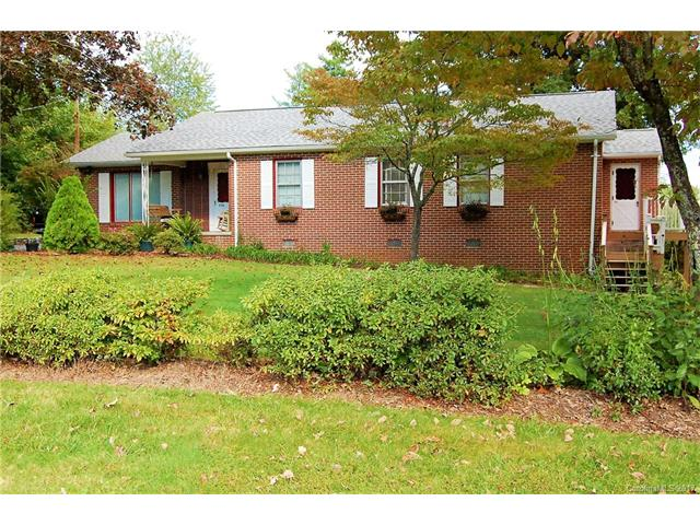 "Beautiful solid brick home w/ 3 bedrooms, 2 Baths, a well-landscaped level lot, close to town, handicapped accessible w/ wheelchair ramp and 36"" wide doors.  Beautiful hardwood floors, and unique handmade butternut wood kitchen cabinets. Outdoor grill with natural gas hookup on the back deck, front & side covered patios, detached garage w/covered carport. Master bedroom could be used as a lockout unit for AirBnB/VRBO (regulations to be confirmed by Buyer's agent) Home Warranty included."