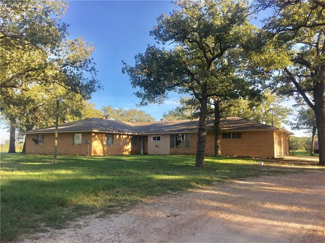 Very spacious home with great trees, storage/outbuildings & just over 5 acres. Outside the city limits, but very close to town. Other amenities include: fenced backyard, dog run, & shop with water & electricity. Must schedule appointment with listing agent. Home is occupied. 24 hour notice is required. Call today!!This listing includes Lee CAD Property ID #s: 18170 & 10567