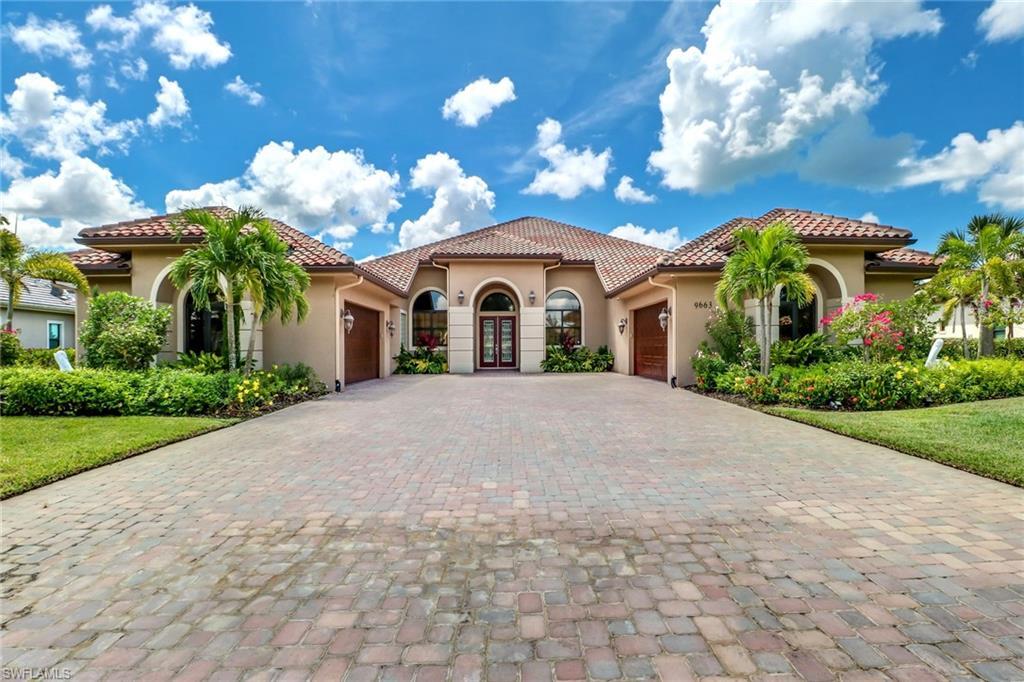 Beautiful Custom Home in Lipari Neighborhood in Treviso Bay. The ONLY 4 CAR GARAGE home in Neighborhood. This open floor plan offers tile throughout, granite counter tops with GE stainless steel appliances such as gas range, wine cooler, and microwave/oven. The master bath has dual sinks, jetted tub and Large walk in shower. This southwestern exposure lake view lanai offers an incredible outdoor living space with gas fire pit, full outdoor kitchen/Bar area. Salt water gas heated pool and spa. 24 Hr Fitness and full service Spa, Resort Pool, Great Tennis program. All this and only 6 miles to 5th Ave!