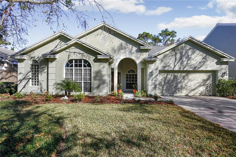 This lovely home in highly sought after Tampa Palms is perfectly located. Its quiet, cul-de-sac neighborhood provides convenient access to the many amenities Tampa Palms has to offer, as well as easy access to area shopping and entertainment.  The gracious foyer is flanked by a formal living & dining room, perfect for entertaining.  Spacious 3 bedroom/2 bathroom split floorplan includes a generously sized home office which could be utilized as a 4th bedroom. Master suite boasts private access to outdoor pool area, master bath with dual sinks, garden tub and separate shower stall, as well as large walk in closet. Two bedrooms adjacent to kitchen share the 2nd bathroom and door to the oversized, screened in pool and outdoor entertaining area. Hardwood, carpet and tile throughout, this home has been well maintained.  Step out onto your PRIVATE lanai through sliding doors overlooking the IN-GROUND POOL and fenced yard.  Roof, A/C and Furnace all replaced in 2016 and carry transferrable warranty. Peacefully secluded yet conveniently located near Wiregrass Mall and Premium Outlets for great shopping, dining, schools, hospitals, I-75 and DOWNTOWN TAMPA! Don't miss out on your opportunity to add your personal touch and call this excellent property home!
