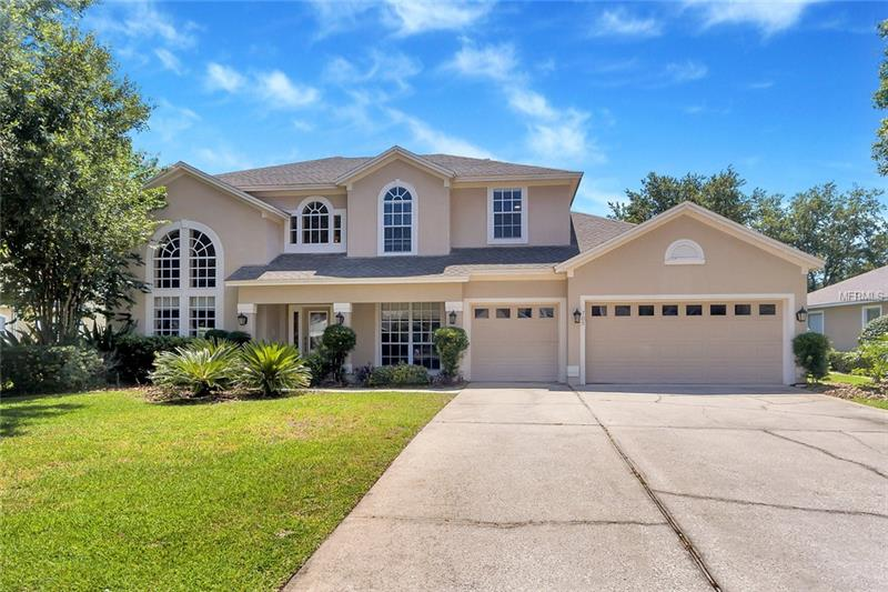 Beautiful 2 Story Modern Contemporary home in Timaquan a Golf Community in Lake Mary with Soaring Ceilings, Large Crystal Chandeliers hanging above the Spiral Stairway featuring wrought iron handrails. The 5 bedroom home has a Great Architectural designers touch. Interior features include All New Crown Molding, Baseboard/Trim and 18 inch Porcelain Tile on the diagonal. The 36 ft long kitchen has been completely renovated including 42 inch Dark Wood Cabinets with high end Granite Counter Tops. There is a Large Kitchen Island. All Kitchen Aid appliances are Stainless Steel to enhance the beauty of the kitchen. All the floors in the house are either laminate or porcelain tile. Bathrooms have been renovated including high end granite. Pool has a brand new gunite and is screened. Surface is cool deck. Two brand new Central AC systems and Washer Dryer. Interior and exterior have been recently painted. Attractive wood burning fireplace in family room. All New Electrical and Plumbing Fixtures. Home includes Full 1 year warranty on all appliances, electrical and plumbing systems. This home has a spacious 3 car garage. The property has so many amenities that there is no room to mention! This home with 3450 sq ft is in Mint Condition and Must be seen to be appreciated!