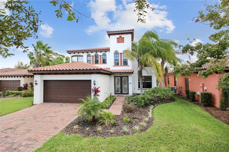 Live the life you've always dreamed of in this exclusive guard gated community. A world-class lifestyle awaits on the banks of the St Johns River with easy access to urban shopping, entertainment, and culture. It is Mediterranean-inspired boasting a tile roof, glass double entry doors, and more. Imagine gathering with friends and family in this suburban delight boasting soaring ceilings and a large screened lanai overlooking your new backyard.  Fresh contemporary kitchen with stainless steel appliances featuring desirable granite countertops, center island for additional meal prep space and overlooks the informal eating space and the family room with access to the private outdoor living space. Main floor guest room with adjacent full bath is perfect for company or multi-generation living while the upstairs living area includes the master bedroom and thoughtfully planned laundry room.  The upstairs loft area allows for additional space for a reading nook, office or whatever fits your needs.  This beauty is located on a quiet, low traffic cul-de-sac street.  Don't forget to bring your boat! This community offers a private boat ramp with access to The John's River. Let the river be your highway as you enjoy a relaxing boat ride to dinner, first class fishing or incredible boating navigable for 120+ miles to Jacksonville and to the Atlantic Ocean.