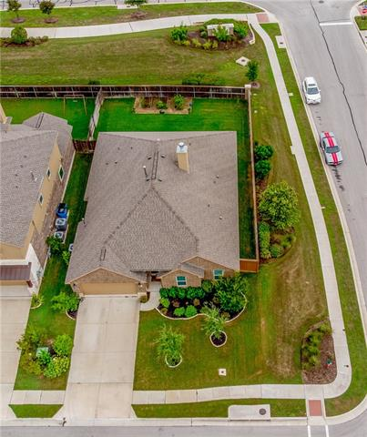 Welcome home to Copper Grassland Way! This beautiful brick home offers the perfect balance of space and function! The open design of the kitchen provides effortless sight and access to the breakfast area, family room, and utility room.  Inviting kitchen accented with beautiful granite countertops, tile backsplash. Impeccable hard tile floors throughout the main areas with carpet in bedrooms. Community amenities include park, pool, nature trail, and soccer field. This home is ready for a family!