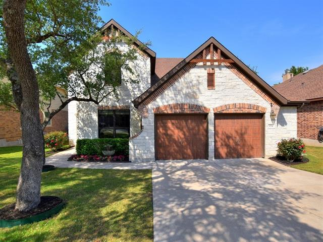 Natural Stone Creates Upscale Curb Appeal That's Accentuated By Lush Landscaping & Large Trees~Open Floorplan Features Downstairs Master Suite + Additional Bedroom/Bathroom - Perfect For Extended Family/Guests; Separate Study & Upstairs Gameroom~Upgrades Include Closets By Design In Master;Above-Ground Hot Tub;Wood Flooring In Master, Downstairs Bedroom & Study;Extended Deck;Fireglass In Fireplace; Bosch Dishwasher & More~Quiet, Family-Friendly Neighborhood  Feeds Into Awesome LISD Schools