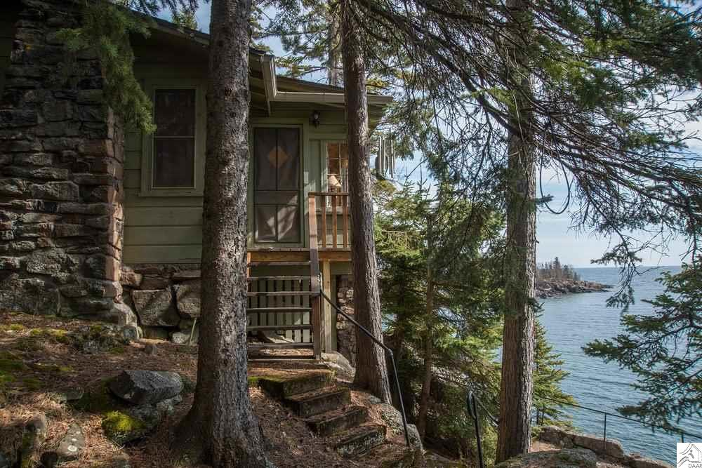 This property is an exceptional opportunity to enjoy the north shore. Because of it's unique building sites and a deep setback from Hwy 61 road noise is completely mitigated and allows you to sit in absolute peace to listen to the waves against your own private shoreline. These seasonal cabins are grandfathered in directly on cliff edge. This is a place you won't ever want to leave when summer is over. If you are looking for property that allows you a unique opportunity to build something new on the existing foundations, these 4 separate cabins provide an unprecedented  amount of possibility. Bring your favorite Architect and an open mind when you're ready to explore this property.