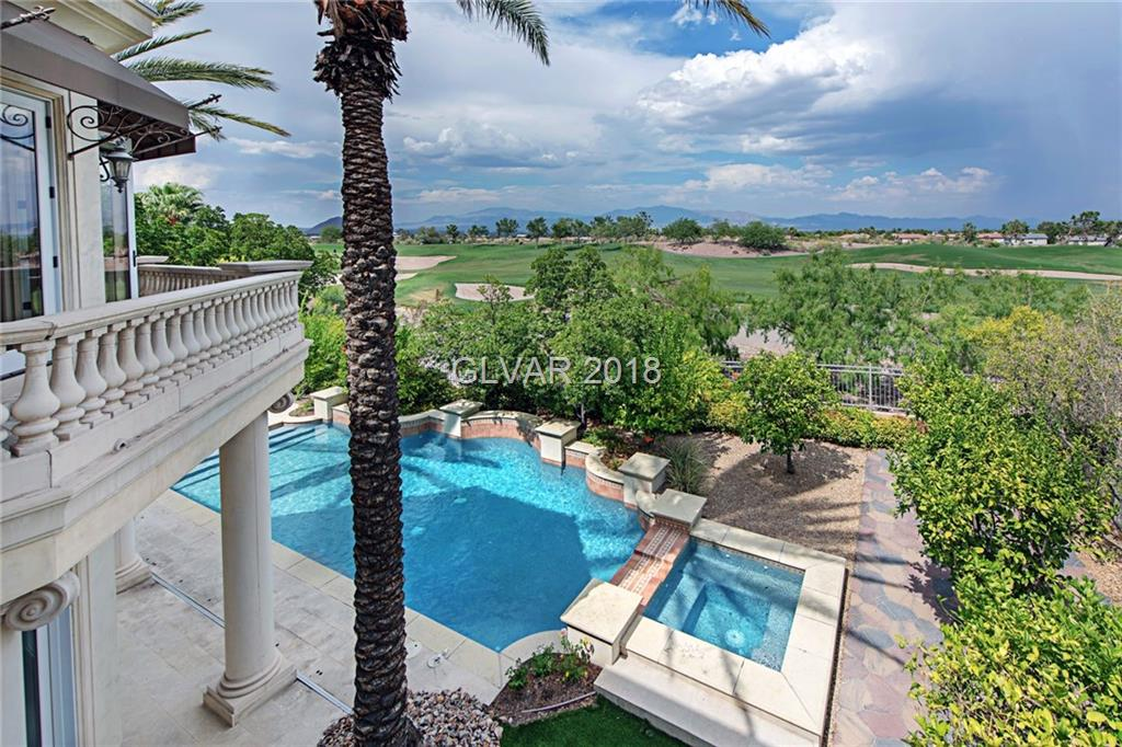 Opulent custom estate on 6th fairway of TPC Las Vegas. Grand entry w/dome ceiling, imperial staircase, wrought iron, & columns. Custom tile & marble, & crown moulding. Elevator. Indoor/outdoor living. Kitchen w/stainless Viking/KitchenAid appliances. Climate-controlled wine cellar. Master suite w/view balcony, hers&his vanities, huge walk-in closet, steam shower, Jacuzzi tub, & bonus room. Rear yard w/Pebble Tec pool, raised spa, & built-in bbq.