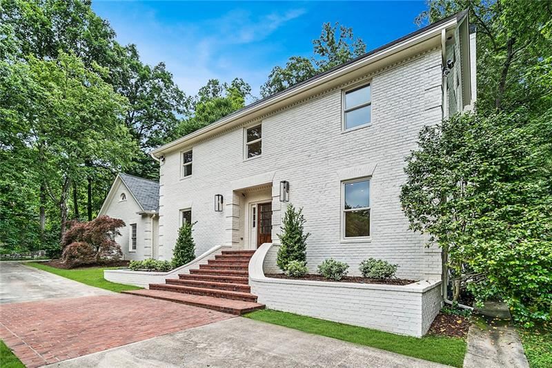Total renovation in Buckhead atop a private 1.2-acre lot on a quiet cul-de-sac street minutes to upscale shopping, restaurants & private schools! Modern white kitchen with Wolf, Sub-Zero,all high-end appliances and marble counters. Kitchen is open to the fireside family room & breakfast room. Sprawling master with spa-like bath. Finished 3rd level w/2nd master or in-law suite plus finished basement. State-of-the-art upgrades throughout~solar panel sys,generator,upgraded security,tankless H2O heaters,waterproofing,5 HVAC units,tons of built-ins,new roof & insulation!