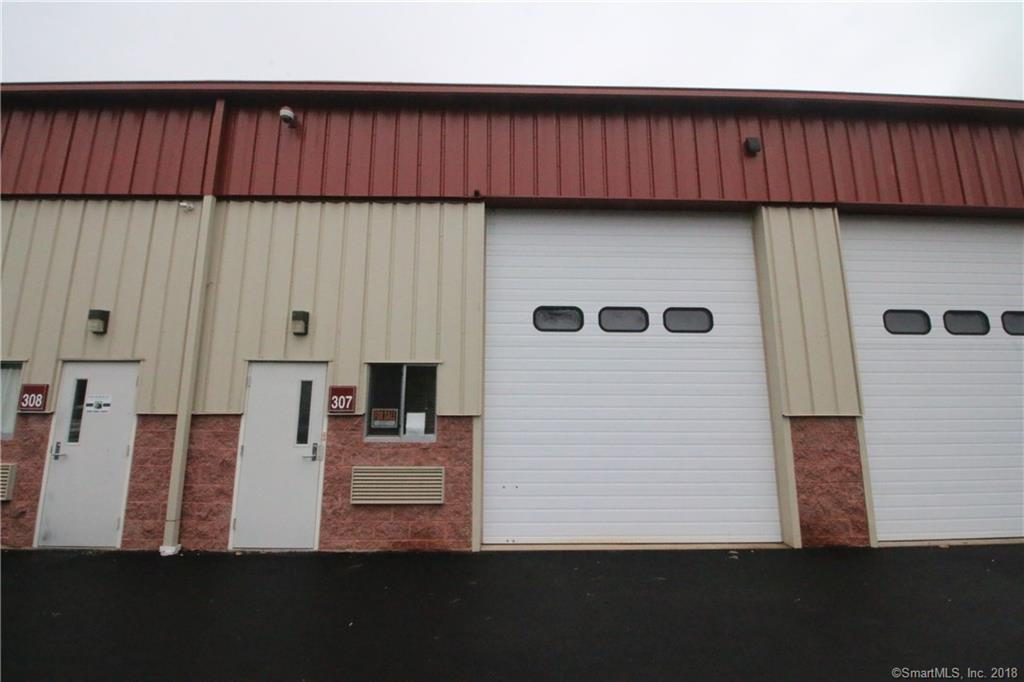 Rare find.  Fully built out Industrial condo. 10x15ft reception area and 11x20 back office area.  Kitchenette and full bathroom with a shower.  14ft door, tall ceilings with a mezzanine for storage.  @40ft deep.  Gas heat, central air.  Low taxes and Hoa's.  This is a turn key unit.  Move, start, or grow your business in this well maintained and convenient area.  30 second drive to rt. 20 connector and I-91.