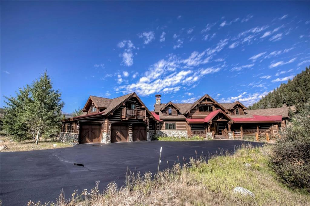 Unique combination of great views, privacy and riverfront land bordering national forest. This quintessential Colorado home with massive log trusses & 3 stone fireplaces will have you reminisce back to the day's when the Rockies were being settled.  Breathtaking great room with log beams creates a feeling of austere rustic luxury.  Main floor master with en-suite bath's on all bedrooms. This private retreat enables fishing, hiking, biking and more on adjacent National Forest. Lockoff Apt.