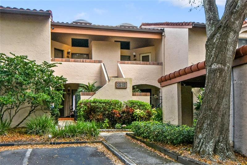 You can have it all…Low maintenance condo living in the heart of the city while enjoying a boating lifestyle! This exceptional 2 bedroom, 2 bath second-floor condo features real hardwood floors, travertine tile in the kitchen, and vaulted ceilings. **This unit includes a COVERED CARPORT, a highly desired feature in the community.** Lake Pineloch Village is a gated community with 24-Hour Security featuring 2 pools, 2 spas, tennis courts, and 2 lakes with boat access, boat dock, and boat ramp into Lake Pineloch. Lake Pineloch is a great skiing lake. Just minutes from downtown Orlando, Winter Park Village, I-4, 408 and Orlando International Airport. If you are in the medical profession you are minutes from ORMC, M.D. Anderson, Lucerne Hospital, Arnold Palmer Hospital and Winnie Palmer Hospital for Women and Babies. Great schools with convenient access, Blanker K-8th grade, and Boone High School are just across the street.** Maintenance includes- pest control, security, private roads, tennis courts, community pool, ground maintenance, and roof. **Live the good life and don't miss your chance to own in this prestigious community!