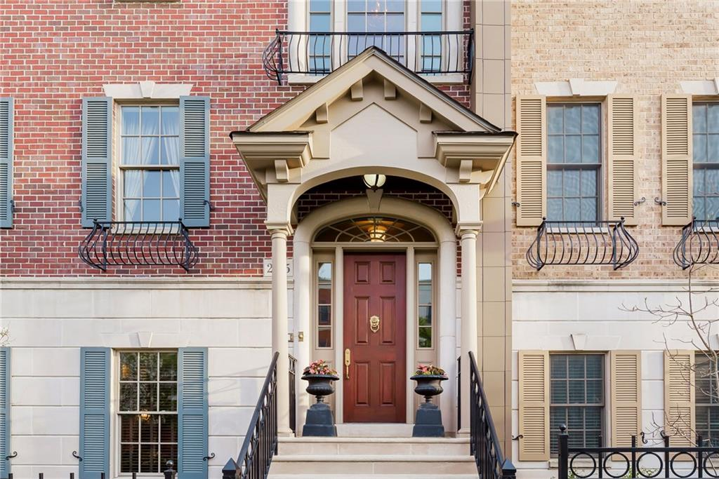 Luxurious living on this custom high end Brownstone in the Village Of WestClay.  Craftmanship at it's finest with gleaming hardwood floors, exceptional tile work, Master shower spa, jet Tub, 300 sqft Attic Storage, 300sqft balcony facing South w/ awning, sound system in all rooms, granite extensive crown molding & custom trim work, stained stair threads w/ runner, built-ins on every level & exterior architecture like no other.  3 Car Garage & your very own private Elevator,  truly One Of A Kind!