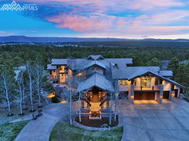 Impeccable Craftsmanship, One-of-a-kind executive residence, 30 Private, Pristine Acres, gated access to property, luxurious Car Barn, Spectacular Guest House overlooking stocked fish pond /Antique Windmill, Massive Pikes Peak Views, No expense spared when it comes to design & comfort, Rich woods make for a Colorado Resort Style of Living, Expansive outdoor spaces *Dramatic covered entry & more *Too may Amenities to list here, full List of features in the Disclosures attached to the listing, RARE Opportunity Now Available!\nThis property is one of the most incredible finds in our area * Special attention to every detail, perfect for entertaining! This exquisite gentlemen\'s ranch, perfectly situated on an incredible 30 acre site to enjoy stunning Pikes Peak and mountain views while not compromising privacy. The home with over 9,500 square feet of indoor living and over 2,800 square feet of covered outdoor space is both grand and unpretentious, a sanctuary for day-to-day living * Guest house is private overlooking the man made lake/pond * Luxury car barn boasts an additional 5,400 sq ft and is the perfect place for the outdoor enthusiast to settle in * The concept alone is hard to find already built and accomplished, just move in and enjoy all of the lifestyle points this incredible gem has to offer * Impeccably landscaped throughout featuring extensive stamped concrete drives, when only the best will do, you owe it to yourself to look here first * This is a MUST SEE for the most discerning buyer! Cannot even be closely duplicated at this value....