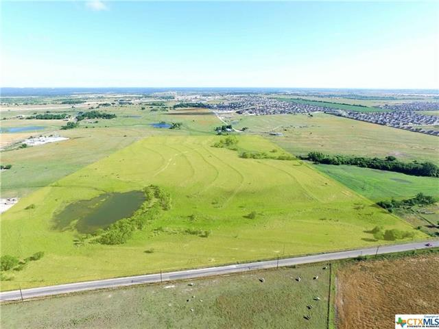 Beautiful ranch close to development in the fast growing town of Jarrell, TX. Over 1300' linear feet of frontage. Large pond. Will consider sub-dividing. Jarrell ISD. Quick access to I-35 and more. Another 40+ adjacent acres available. Excellent investment for future.