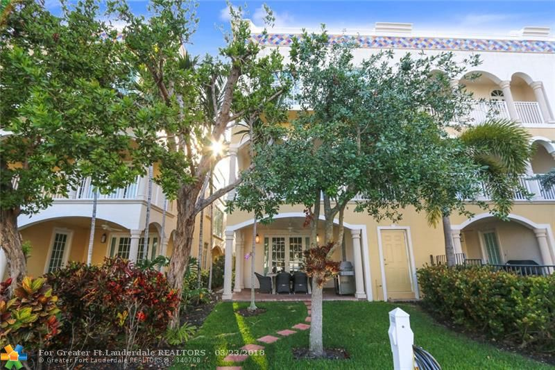 Waterfront 4 bedroom, 4.5 bath townhome with private elevator and dockage in Las Olas Isles. This corner unit townhome has a modern gourmet kitchen, dining area and a family room with a covered balcony. First floor entry room used as a game or family room with a waterside patio. A large master bedroom, walk in closets, marble flooring, with a loft area that leads to your own rooftop deck & amazing water views. Gated two car garage , dock and great location for walking to the beach and restaurants.