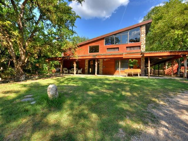 This majestic piece of property consists of 3.53 acres with mature trees, and is adjacent to LCRA land.  A Perfect Family Compound.  2 homes on the property. Main House is 2464sf (per TCAD) 4 bedrooms /2.5 baths with 4th bedroom on 2nd floor w half bath & balcony, or Game/family room. Wrap around covered Front Porch. 2nd Home/Structure 1698sf (TCAD.) Barn/ 3 car garage. Well water or tap into water line on FHPR.  5,000 gal Rainwater Tank. Zoned DR.  Easy access to Lakeway and 2222.