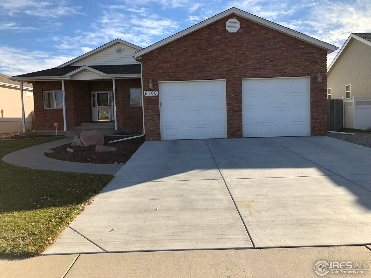 Great home in West Greeley. Low maintenance exterior with brick and vinyl siding. All new flooring, refinished dining, kitchen and laundry wood flooring. New roof (August 2018), new patio and driveway concrete. Garage is tandem. Open floor plan with gas fireplace with new luxury vinyl flooring.