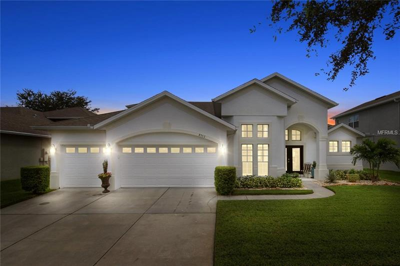 **No upgrade has been missed!** Luxury estate section in gated Vista Lakes with resort style amenities. Sprawling main floor features crown molding, tray ceilings, upgraded light fixtures, seamless shower, plantation shutters, hardwood floors in all bedrooms, tile in wet areas, 12 ft ceilings, new interior/exterior paint & WHIRLPOOL WASHER/DRYER INCLUDED! Gourmet kitchen, formal living & dining, main floor master with a reading nook area, & bonus loft, bedroom with full bath upstairs add to the appeal. Grand formal dining room with tray ceiling. The adjacent formal living room has French doors to extended enclosed lanai. Central kitchen features VIKING STAINLESS STEEL APPLIANCES, walk-in pantry, display cabinets, center prep island, breakfast nook with a view that provides abundant natural light. Spacious family room has beautiful French doors to access your beautiful outdoor living area. The split floor plan provides an escape to your private master suite with tray ceiling, reading nook and a large master bath. Kick back and relax on your enclosed lanai with tile or enjoy the private landscaped yard with a newer easy care white vinyl fencing. Enjoy amenities for every taste & location just minutes from Lake Nona Medical City, Orlando International airport, shopping, dining & more.