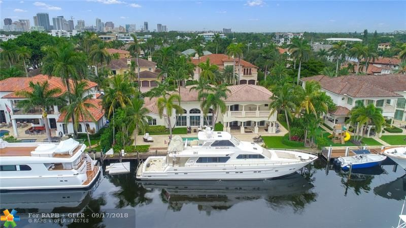 Yacht Owners dream on one of Las Olas' finest Isles. 125' of coveted waterfront permits you to dock up to 105' yacht. 2nd home from the point allows for easy navigation on this wide, deep waterway.This luxurious home has an open floor plan of the kitchen and living area space with volume ceilings and a built in bar for family entertaining.The spiral staircase leads to your private , spacious master bedroom with walk in closets and a terrace overlooking the waterway. A large covered lanai with a summer kitchen to enjoy the pool,spa and east ocean breezes. Nurmi Isle has underground utilities.