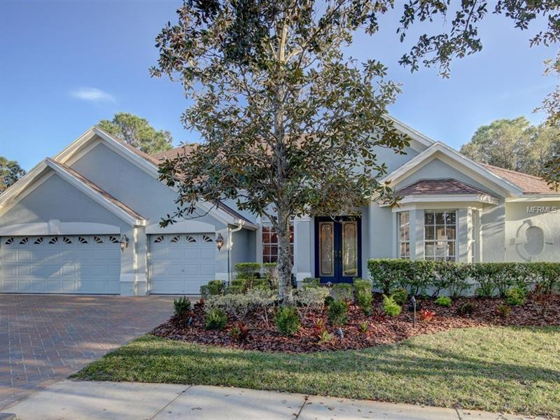 """GORGEOUS, GATED  5 Bedroom 4 Bath, Den, Bonus w/ almost 3700 s.f  w/ 3 car garage in the Greens of Westchase. VISTA INFUSED 1/4 ACRE lot on the 7th HOLE is tucked away from cart path & neighbors.  Dbl. LEADED FRONT DOORS, Den w/ DBL GLASS DOORS and STAINED GLASS TRANSOM,  LIGHTED ART NICHES, 5 1/4"""" CROWN MOLDING, CASEMENT molding,  and FIREPLACE w/ WOOD MANTLE & SURROUND,  make a SPECTACULAR STATEMENT. UPDATED MASTER BATH with SPA TUB & walk-in shower w/SEAMLESS GLASS. WOOD CABINETS w/SOFT CLOSE drawers, GRANITE,  & CLOSET ORGANIZERS in most closets & HARDWOOD FLOORS IN MOST areas.  Kitchen features 42"""" WOOD CABINETS with CROWN, GRANITE, PULL OUT SHELVING, ISLAND, B-IN DESK, dbl. pantry, under cab. lighting, bar seating, STAINLESS appliances, & Mitered glass window at eat-in.  Laundry rm SINK W/ 42"""" UPPER & LOWER CABS.  Warm & inviting Family Rm features POCKET SLIDERS, built-in shelving with fixed window & SURROUND SPEAKERS. Pool & hall baths UPDATED WITH STONE TILE,  WOOD CABINETRY & GRANITE.  Security system, coach, flood and landscape lighting front & back, TRANE 16 SEER AC'S 2015. Screened pool w/ PEBBLETEC / SPILL OVER  SPA HTD IN 2018. BRICK PAVERS at pool, 2 trussed patios, drive & walkway.  B-IN SPEAKERS in master & bonus  w/ volume controls.  WESTCHASE is famous for its SCHOOLS,  TIGHT KNIT FAMILY ATMOSPHERE , WALKABLE AMENITIES & WESTPARK VILLAGE.  Pools, Tennis, Parks, Playgrounds, Fitness Stations, & Golf Course. Close to Tpa Int. Airport, Gulf beaches, Hospitals, Shopping, & Restaurants."""
