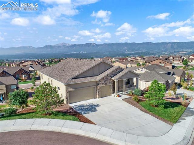 Massive views of Pikes Peak, Air Force Academy, city lights & front range*Sited at the back of a private cul-de-sac, siding to open space*One Owner Vantage Nakota loaded w all the goodies*Great room w/ stone fireplace expertly designed adjacent to gourmet kitchen w huge center island, generous dining space accented by Plantation shutters*Luxurious master w/ gorgeous bath & ample W/I closet, 2nd bdrm / office & bath on main*Finished walkout bsmnt w 2 addt'l bdrms, family rm w 2nd fplc, rough in for future junior suite...