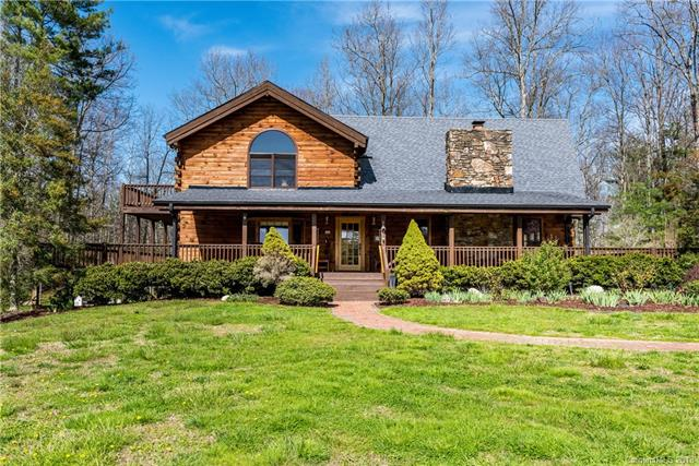 Fantastic Log Home On 5.22 Acres!  2 Bedrooms (Easily Converted To 3), 2.5 Baths, Huge Great Room W/Beamed Cathedral Ceilings & Ceiling Fan & Huge Rock Fireplace/Woodstove & Pine Floors, Dining Area W/Pine Floors & Bay Window, Large Kitchen W/Granite Counter Tops & Breakfast Bar & Ceiling Fan & Pine Floor & Pantry, Large Master W/Beamed Ceiling & Ceiling Fan & Walk-In Closet & Whirlpool Tub & Separate Shower & Bay Window, Large Family Room W/Domed Window & Vaulted Beamed Ceiling & Balcony, Gas Furnace W/Central Air (Approximately 7 Years Old), Inactive Security System, Full Basement (Almost Completely Finished), Huge Wrap-Around Deck (Partially Covered), Generator, 2 Car Garage, Large Barn/Workshop W/Attic Storage Space & Woodstove, Home Warranty, And Much More!