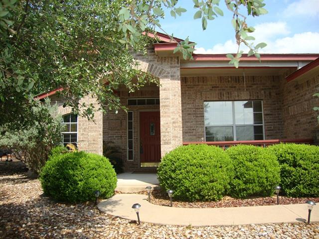 Pictures were taken before Owner moved out.  Spacious Open floor plan  Single Level with covered Deck on Back of Home. Nice Hill Country & Golf Course view. Has Wrought Iron Fence and zero-scaped yard. 3 Bedroom and 2 full Bath with Master having a wall in Shower w 2 shower heads. Walk-in Closets.  The kitchen is perfect for entertaining opens into 2 dining areas and Living area with fireplace. Oversized 2 Car Garage.
