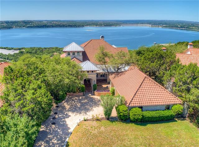 Unobstructed panoramic views of Lake Travis & Texas hill country await from this magnificent custom estate! An entertainer's delight w/a spacious open floor plan & breathtaking views from almost every room! The main living area spills onto an expansive patio through walls of glass doors that slide open creating one huge seamless entertaining area! Chef's kitchen w/butler's alcove, fossilized limestone, wood floors, & lower level wine cellar! Sits on 0.365 acre behind a private gate w/a fabulous courtyard!