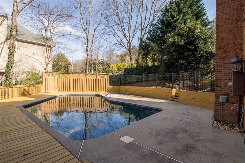 Privacy abounds in this oversized heated salt water pool! Views of the backyard & creek are stunning!