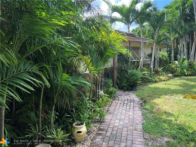 HARDLY AVAILABLE HOME ON A MOST SOUGHT AFTER NEIGHBORHOOD ON A GREAT SCHOOL DISTRICT. HOUSE SITS ON A CUL DE SAC LOT WITH A HUGE BACKYARD, LOTS OF GREEN AND A SCREEN ENCLOSED POOL. HURRICANE SHUTTERS THROUGHOUT. SELLER IS IN THE PROCESS OF MOVING OUT. HOUSE IS IN GOOD CONDITION. NEW FLAT ROOF ON THE LANAI AREA. TITLE ROOF WITH APPROX 15 YEARS LIFE WARRANTY.  PICTURES OF THE INSIDE OF THE HOUSE WILL BE ADDED ONCE ALL THE BOXES AND FURNITURE ARE REMOVED FROM WITHIN. **HOUSE PRICED TO SELL QUICK. DON'T MISS THIS OPPORTUNITY AS IT WON'T LAST!**SOLD AT AS-IS CONDITION WITH RIGHT TO INSPECT.**