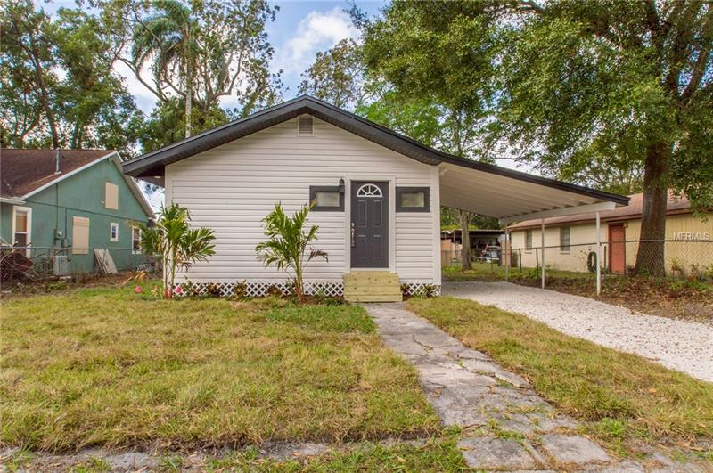BACK ON THE MARKET!!! Absolutely charming 1924 Bungalow located just steps from the Hillsborough river in Seminole Heights. This home boasts a open layout with plenty of room for entertaining plus a workshop that could easily be converted into an in-law suite. Beautiful laminate floors throughout except for the two carpeted bedrooms.  It also features new kitchen cabinets with granite countertops, tankless water heater, new a/c, and new stainless steel appliances! You can walk just steps from the home to the Henry and Ola park.