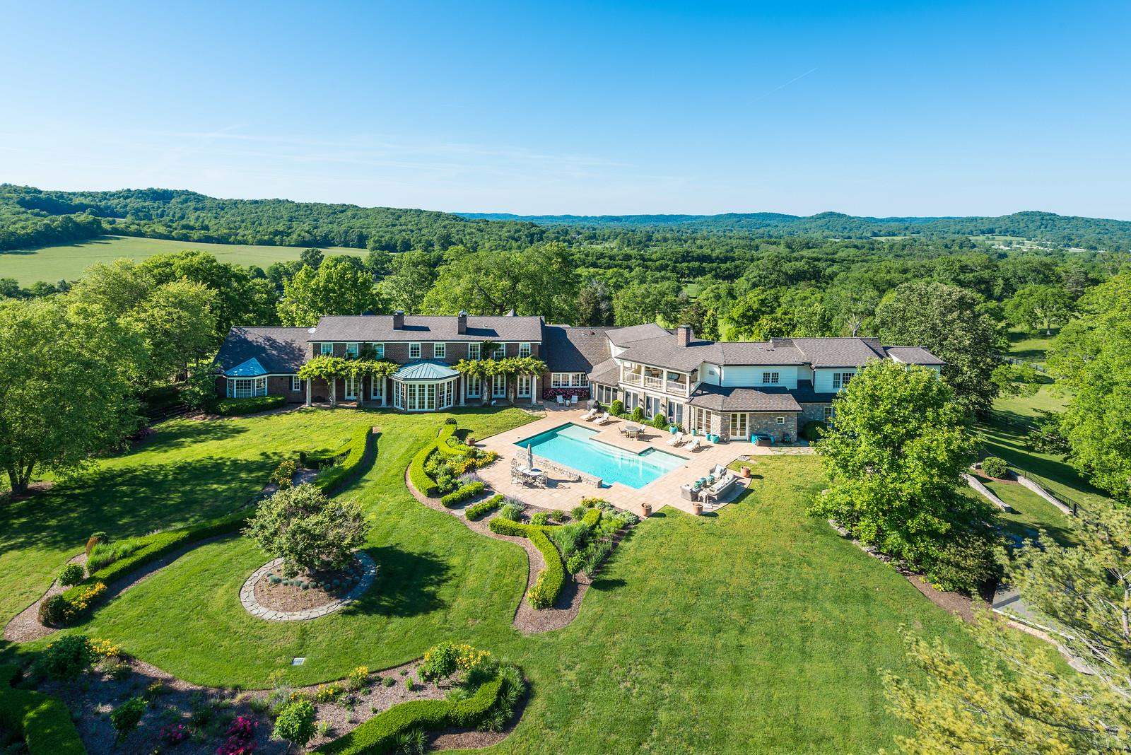Commanding panoramic VIEWS.46 acres.Epicenter of 'in-town' equestrian activity.1500 ft River Frontage.Expansive 10,000 sq.ft.'Hampton's Style' brick Main Residence.Retreat to Guest/Bluff house.'Pool House',Screened Porch,Outbuildings.