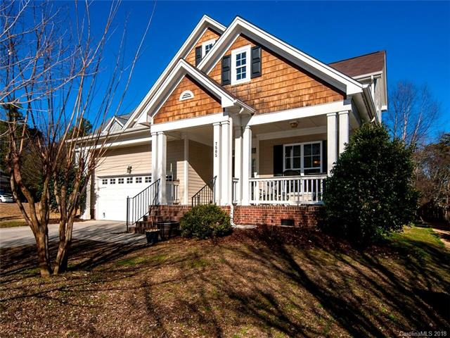 Priced Reduction.  Freshly painted & professionally cleaned.  Seller is ready to move!  Charming front porch home in Tega Cay.  Hardwoods adorn most of first floor with gas FP in 2-Story Great Room.  Owner's Suite on main level with garden tub, dual vanities and large W/I closet.  Spacious secondary bedrooms on upper level with large bonus room.  Unfinished room could be additional square footage.  Large laundry room on main level.  Desirable Tega Cay community activities.