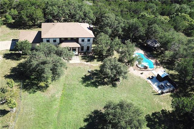 AGG EXEMPTION!  Bring the boat, horses and RV's!  Enjoy the privacy, tranquil Texas hill Country sights and sounds of this custom home with with your swimming pool, outdoor kitchen, cabana or Sauna. Upgrades: remote controlled gate, high game fence (front perimeter), Mueller metal building(huge), Kinetico 8 stage water filtration system, outdoor sauna, patio with custom fire pit, full outdoor kitchen, renovated bathrooms and kitchen, 2 metal hunting blinds, outdoor lighting, Wood Floors, paved driveway.
